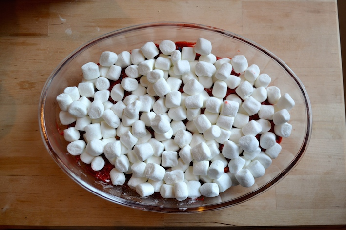step 3 a giant bowl full of red velvet s'mores dip topped with marshmallows and m&m chocolate candies batter