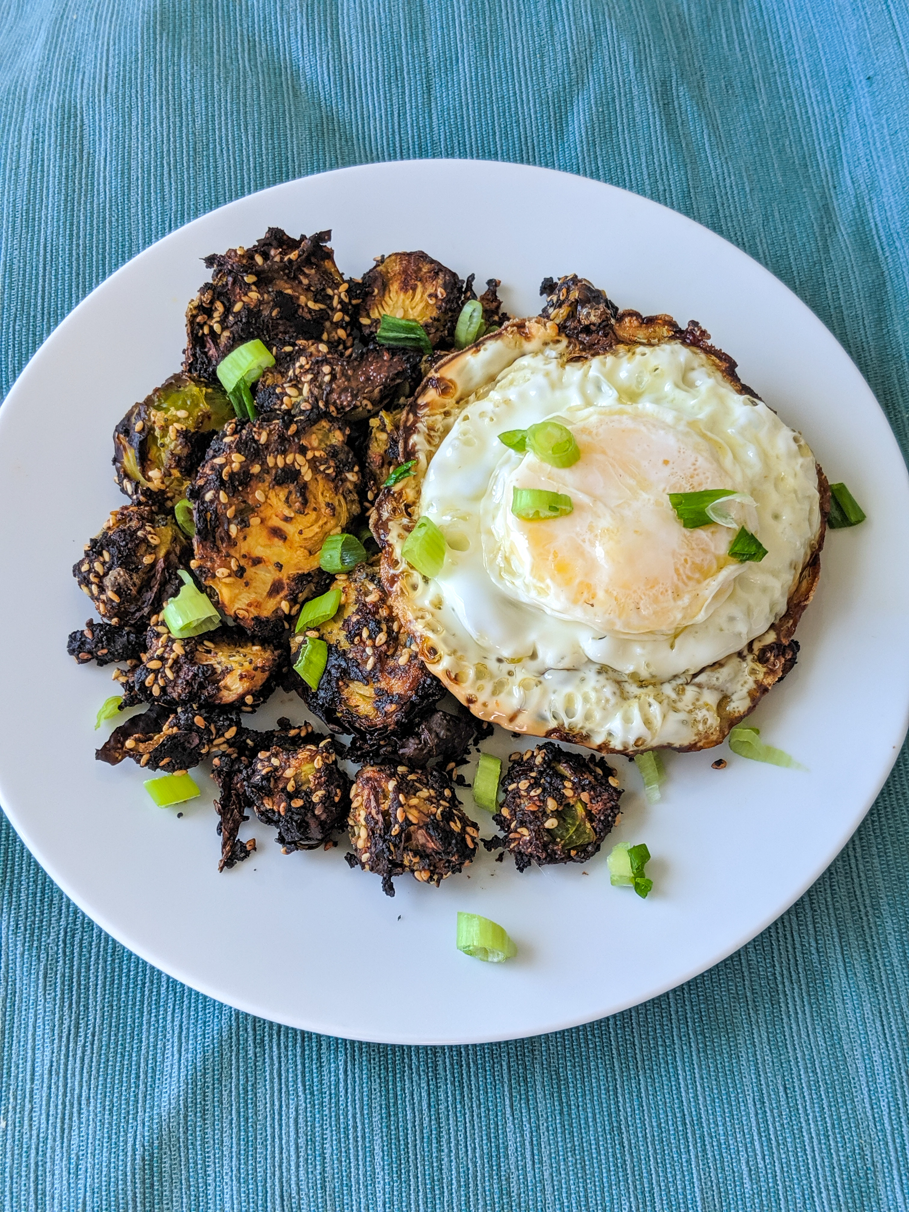 Everything Brussels Sprouts with a fried egg and scallions
