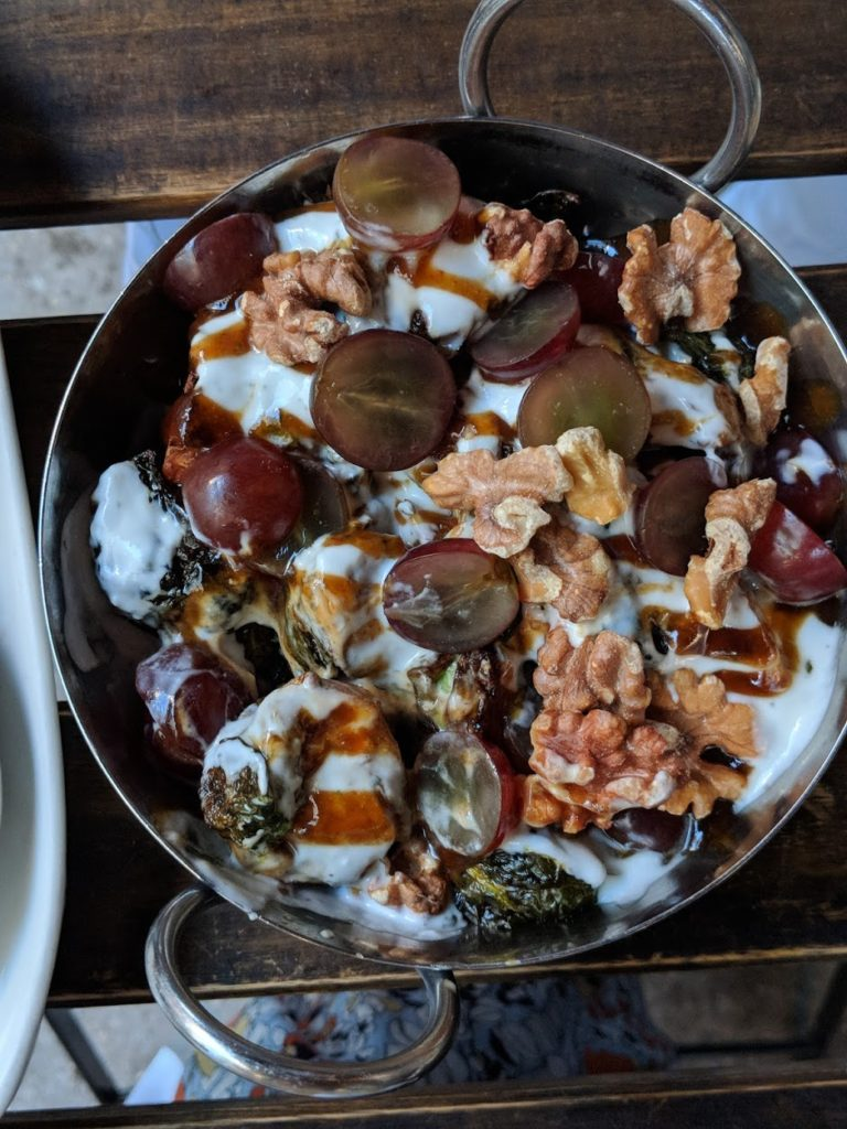 Brussels sprouts with grapes, fig jam, walnuts and mint yogurt at ilili in nyc