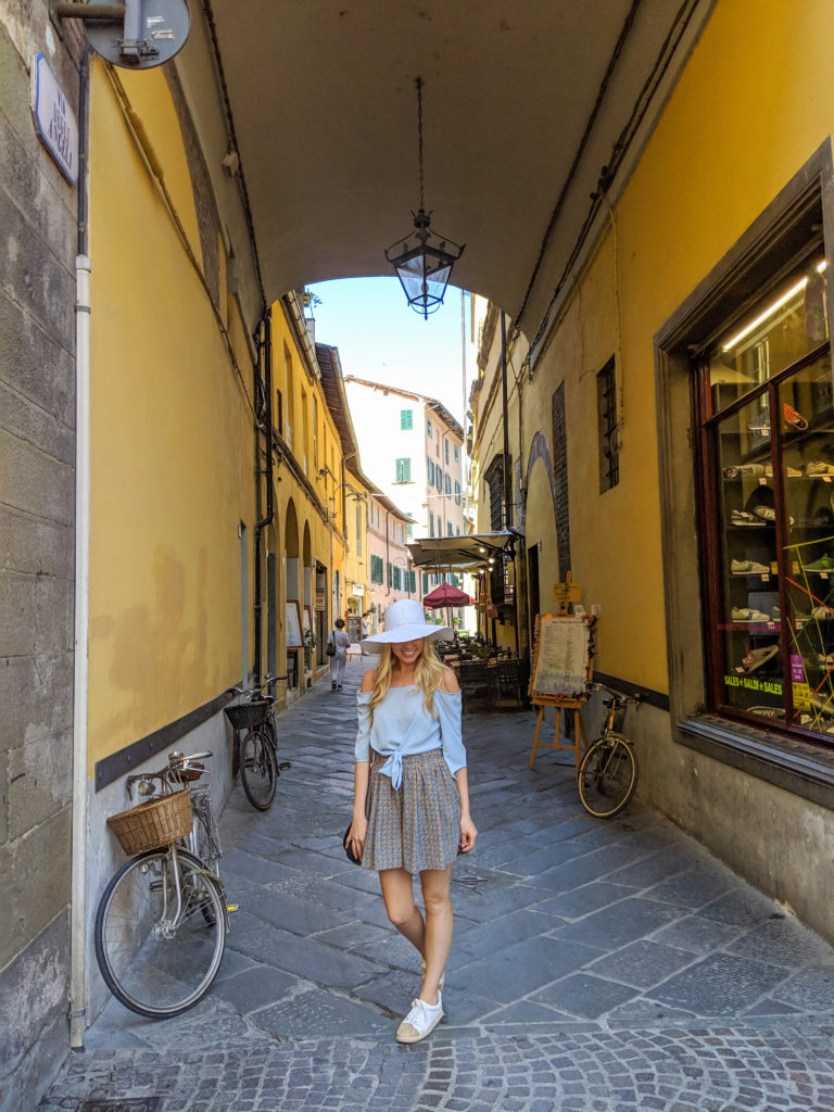 Woman walking in Lucca Italy
