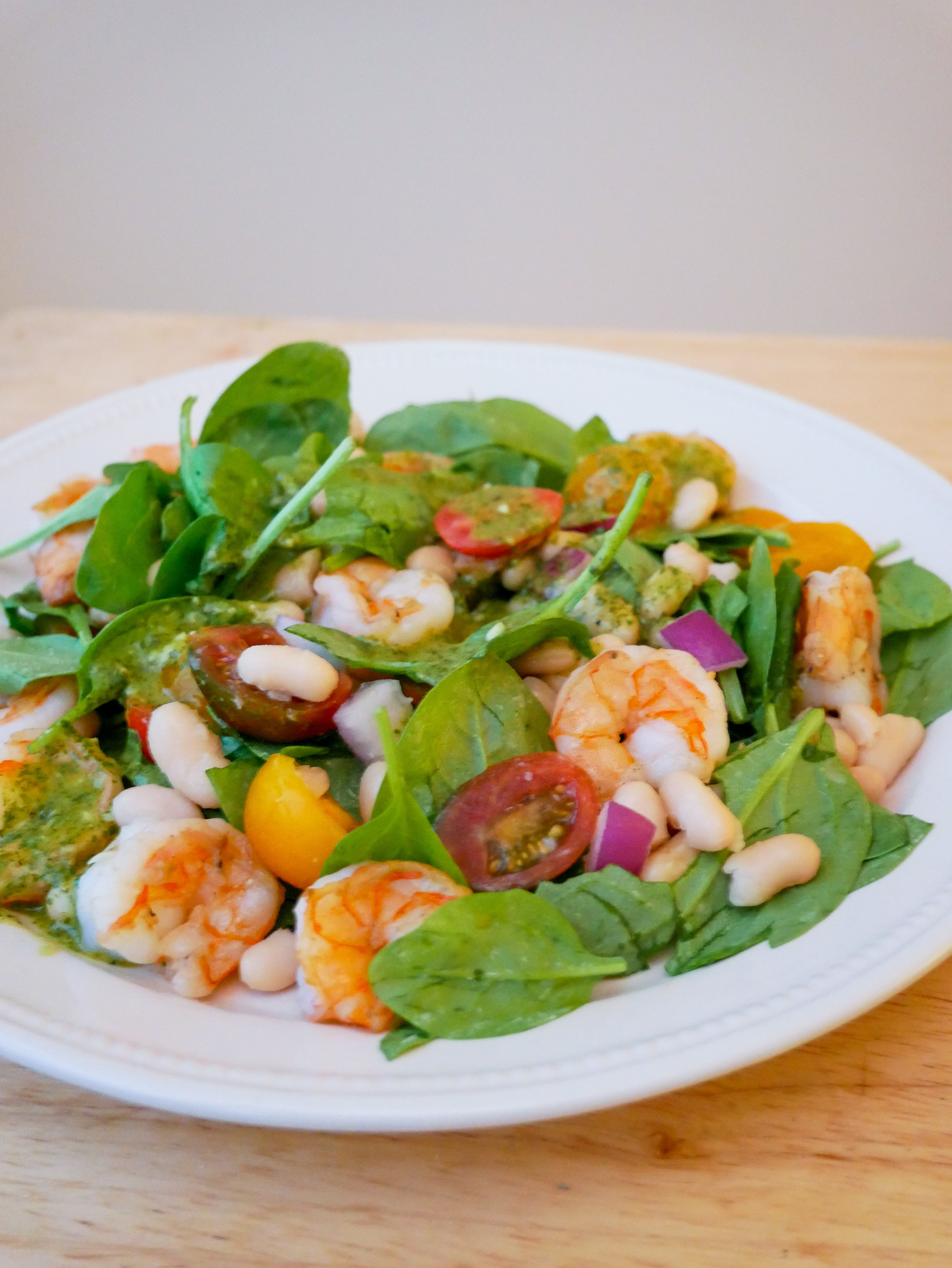 Spinach salad with shrimp, cannellini beans and a cilantro garlic lime vinaigrette