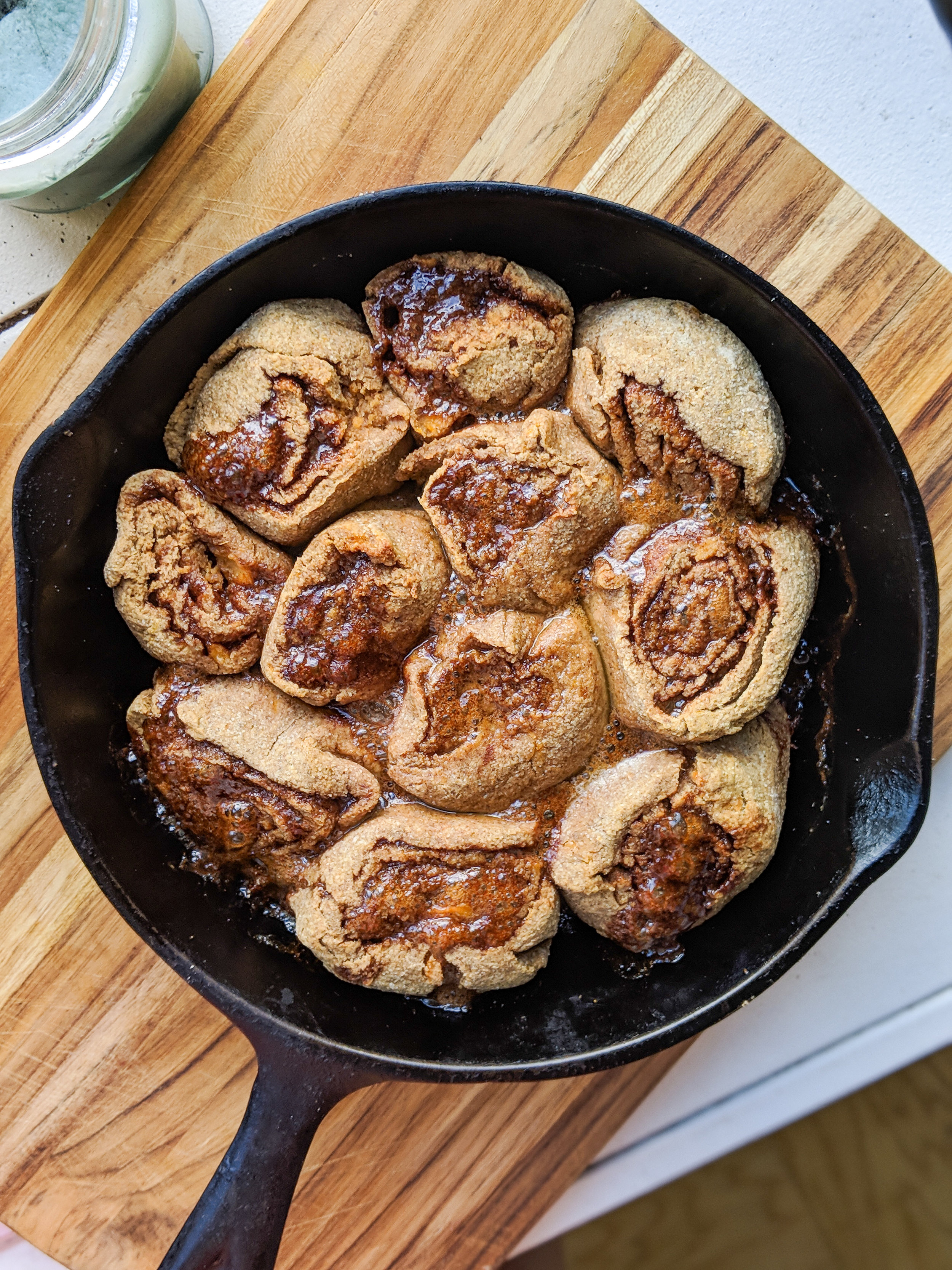 A skillet of sweet potato oat flour cinnamon rolls with cinnamon streusel