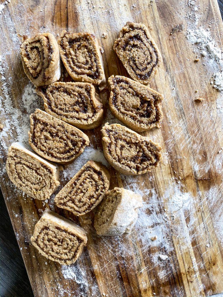 A skillet of sweet potato oat flour cinnamon rolls with cinnamon streusel