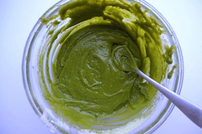a bowl of matcha cupcake batter bright green