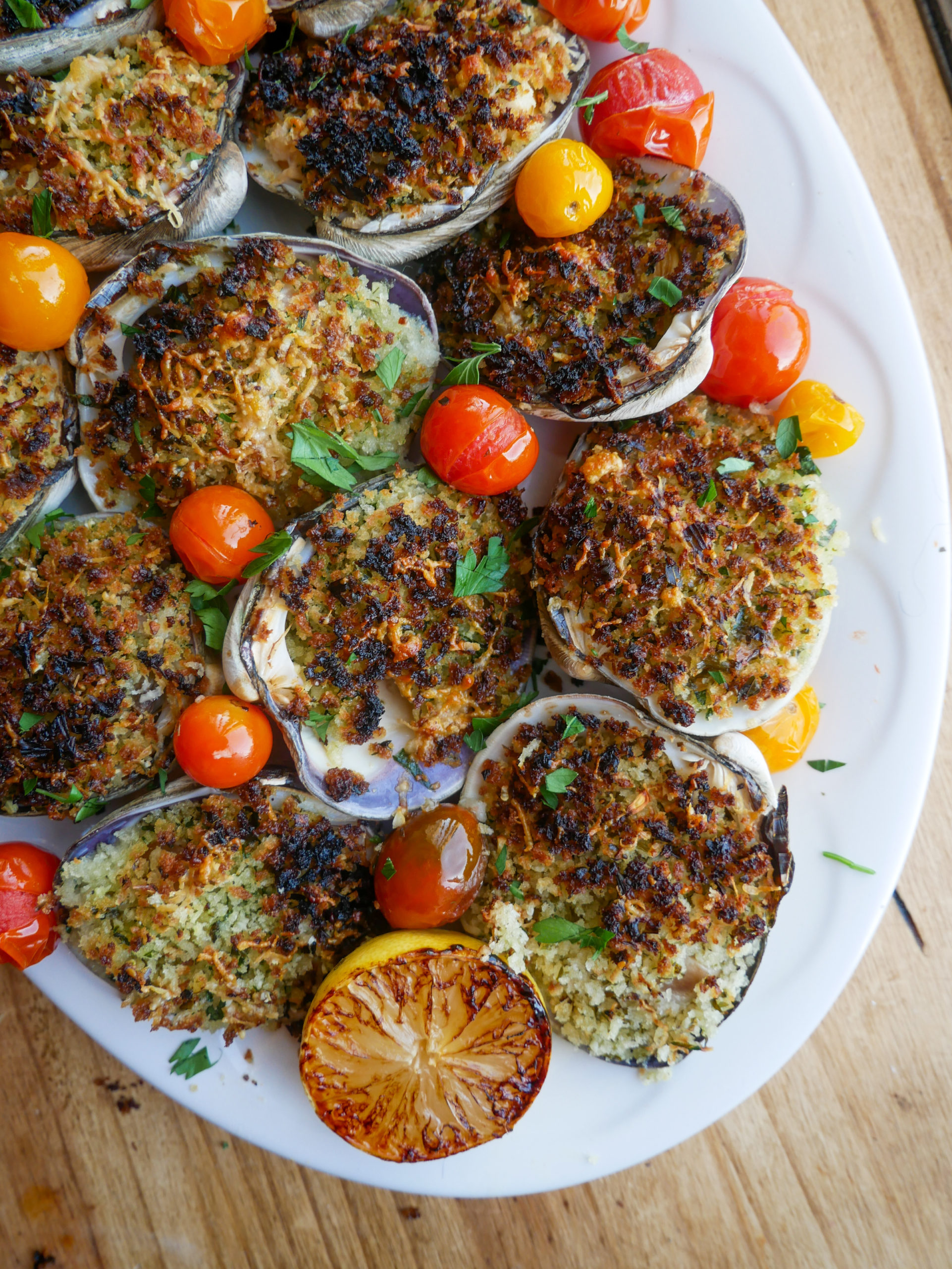 a platter filled with Baked Clams with White Wine Tarragon Butter