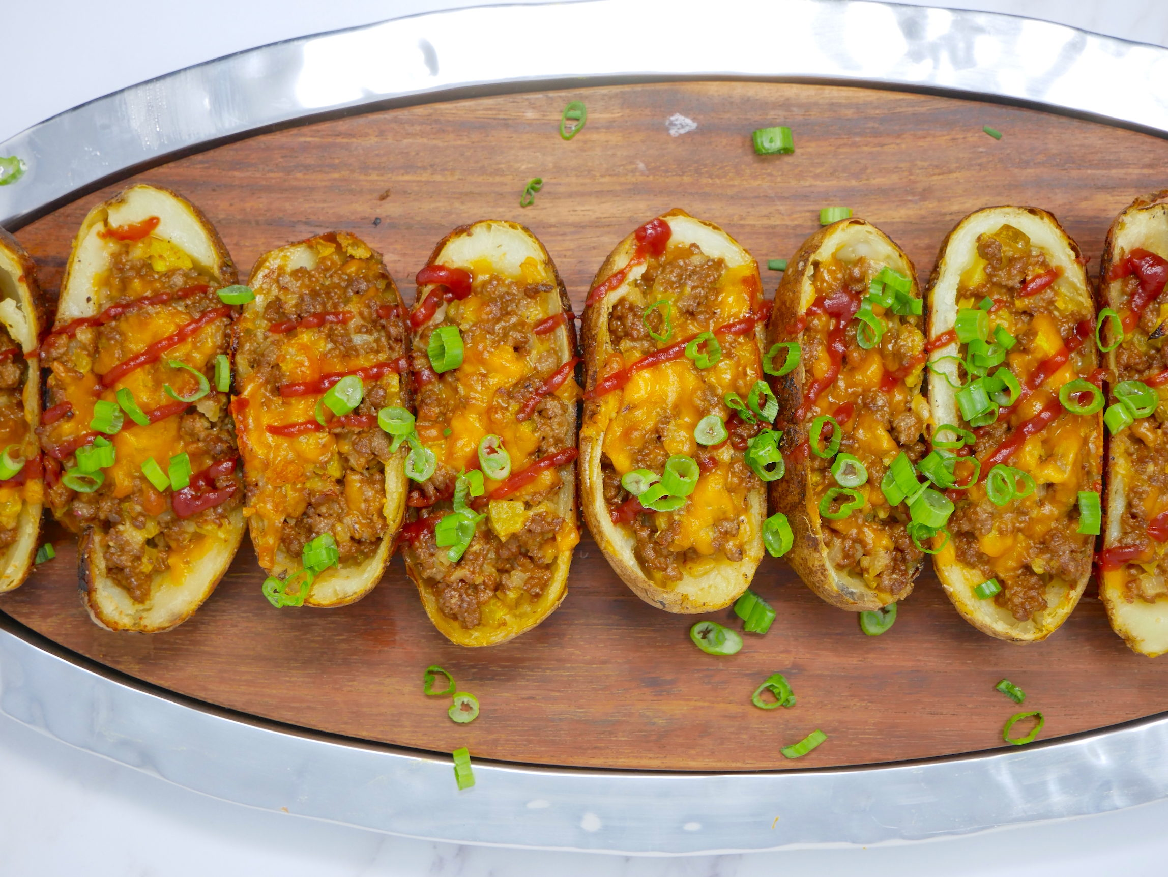 a platter of cheeseburger potato skins