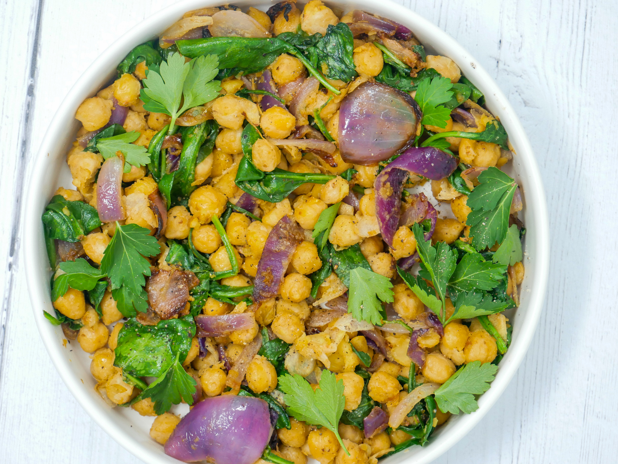 a bowl of dijon chickpeas with red onions and parsley