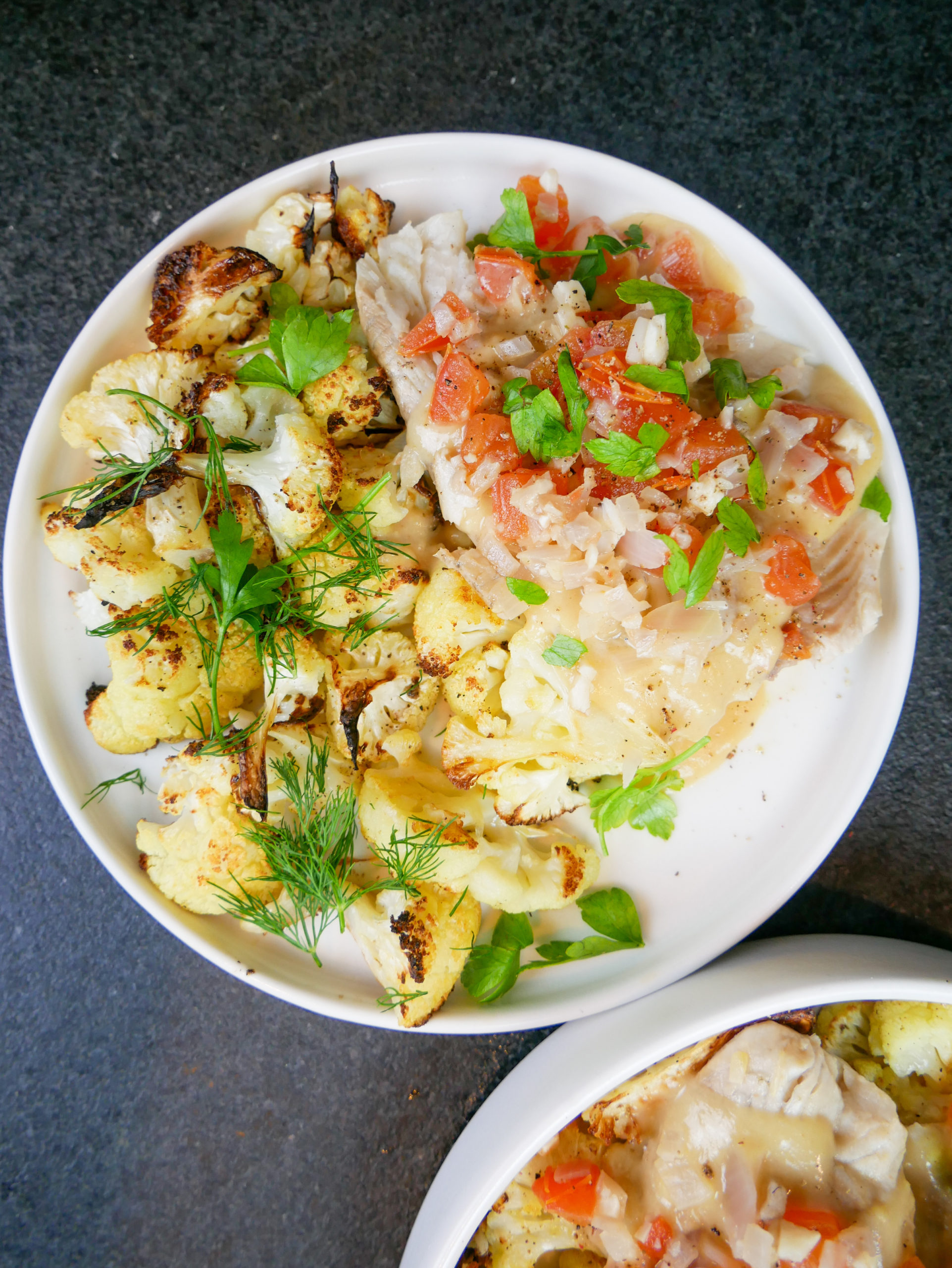 poached white fish in wine with cauliflower
