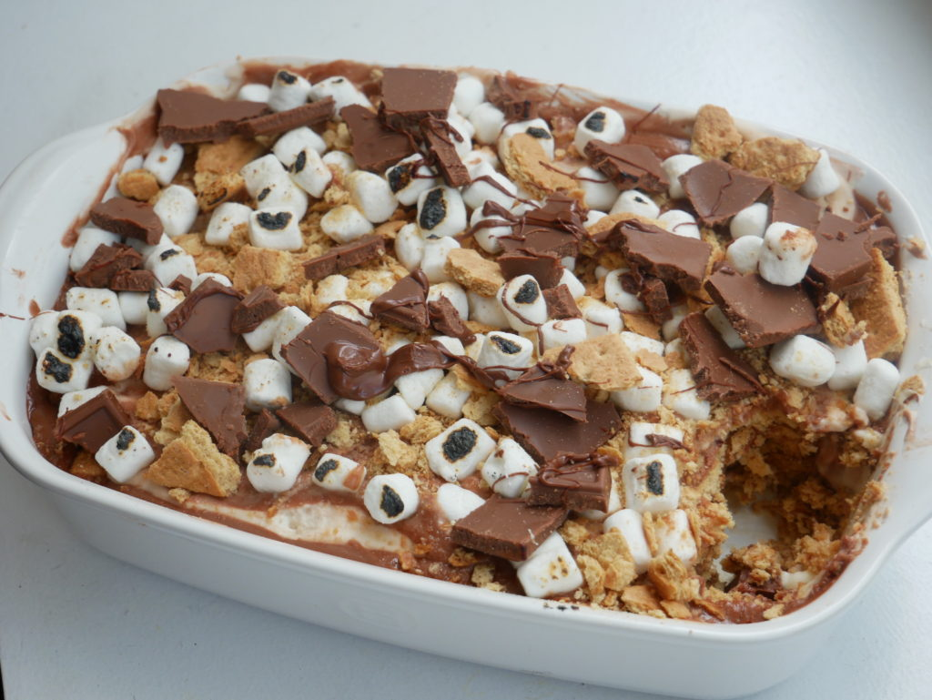 smores icebox cake with toasted marshmallows and nutella drizzle