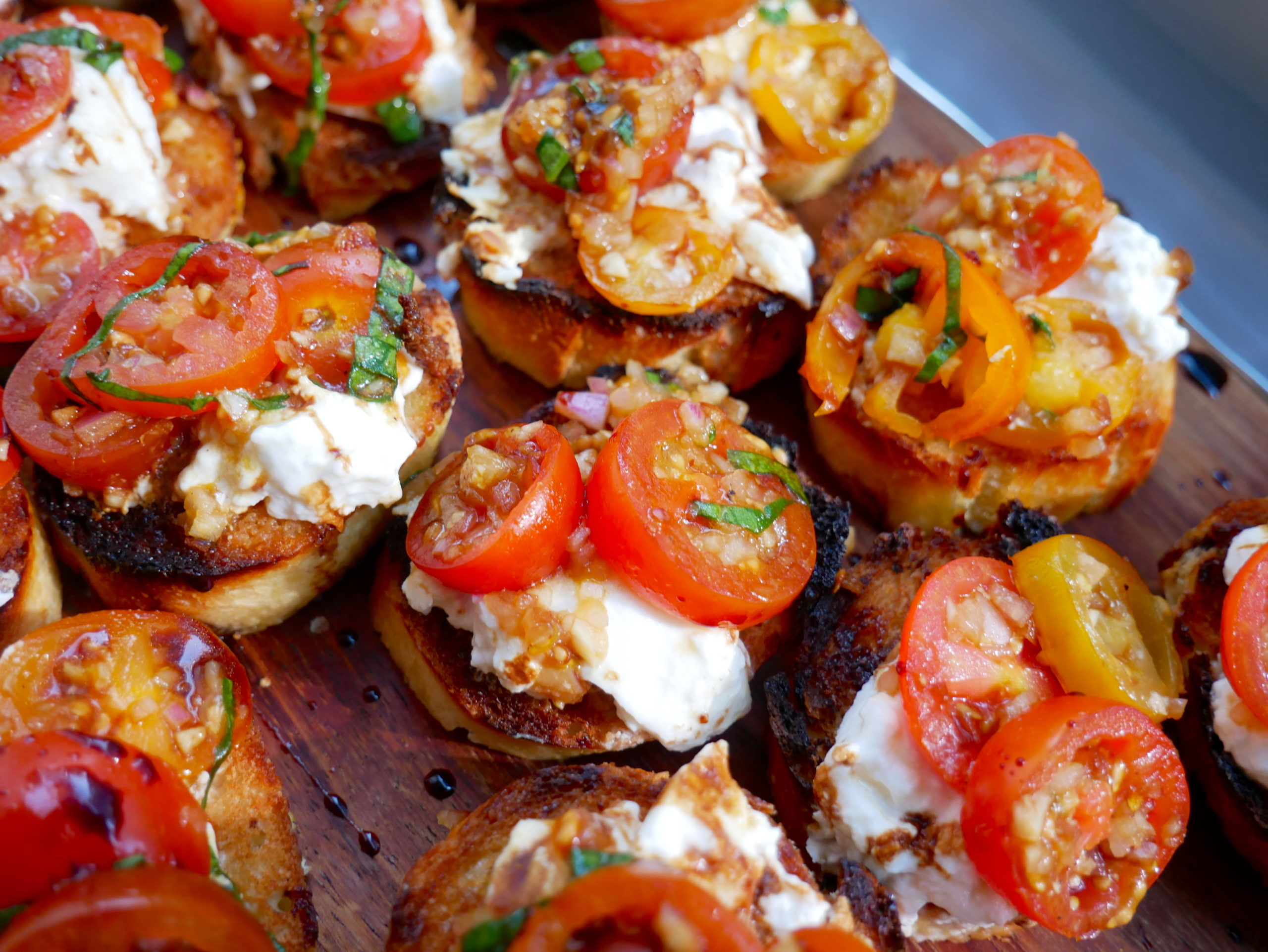 burrata bruschetta with tomatoes, balsamic glaze, and burrata