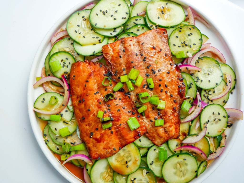 baked soy salmon on cucumber salad asian
