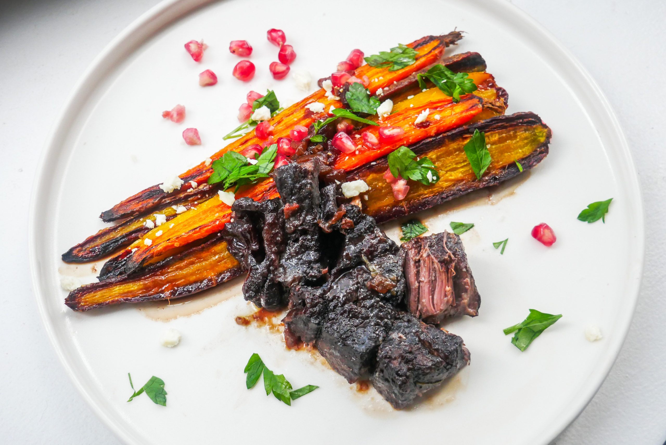 Red Wine Pomegranate Braised Short Ribs with Rainbow Carrots