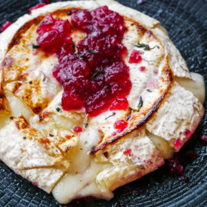 Baked Garlic Goat Brie with Cranberry, Rosemary and Thyme