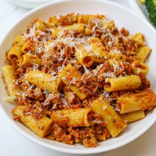 a bowl of pasta in a ground turkey red sauce
