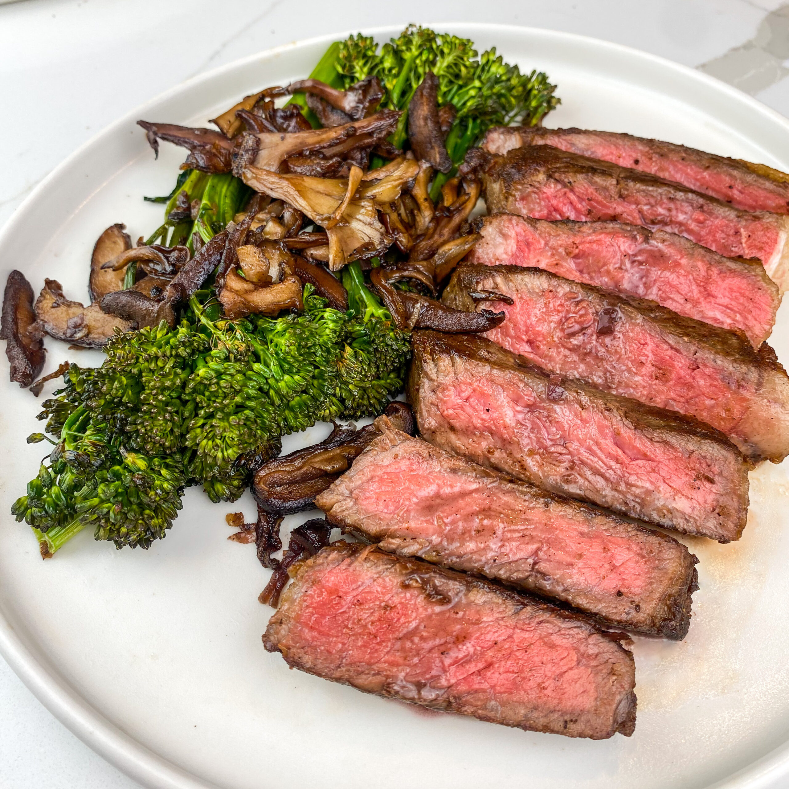 pan seared steak with red wine glazed mushrooms