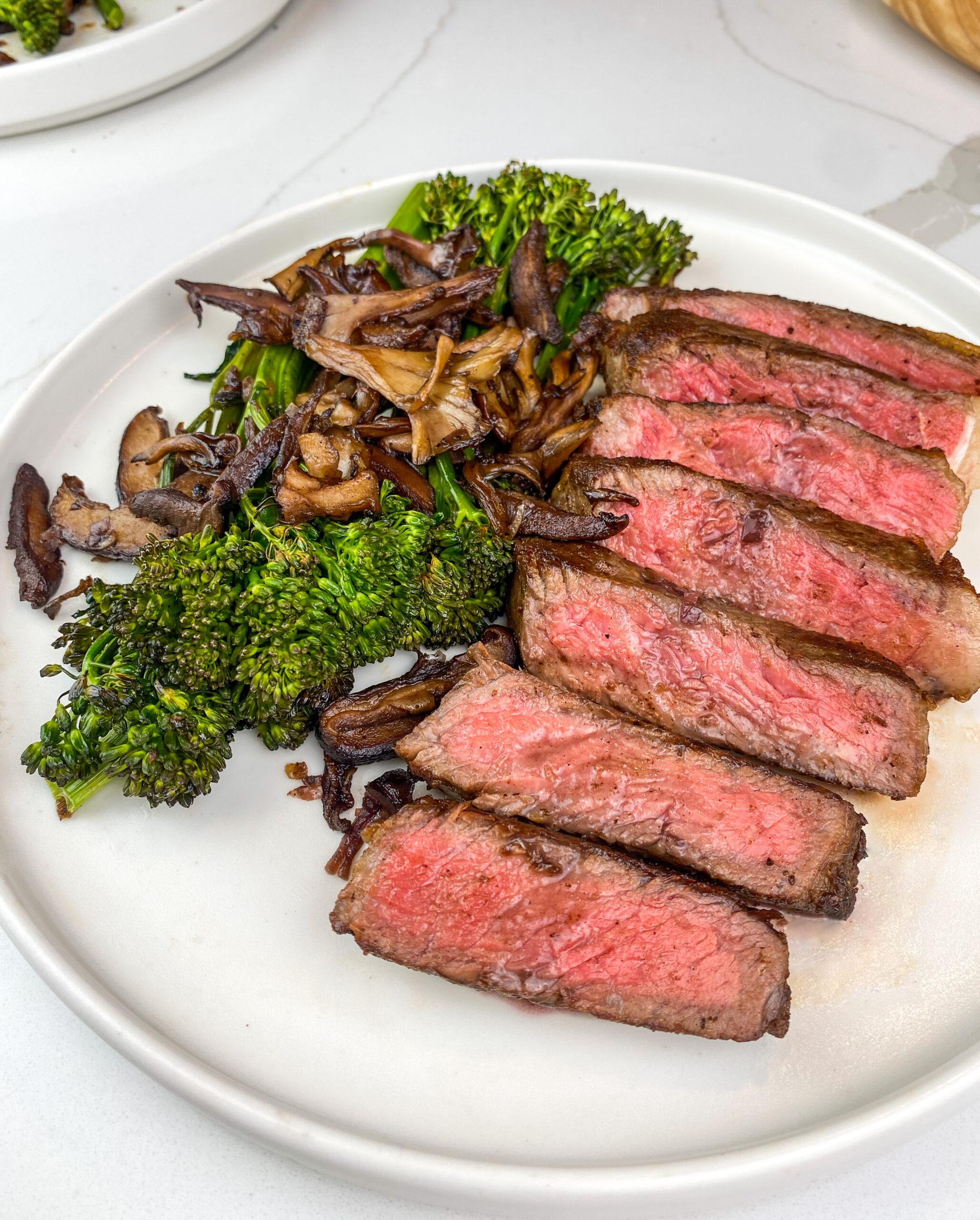 pan seared steak with red wine glazed mushrooms